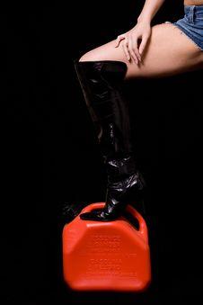 Sexy Leg On Gas Tank Royalty Free Stock Photos