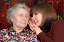 Free Grandmother And Granddaughter Gossiping Royalty Free Stock Image - 4925376