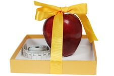 Red Apple In Box With Tape-line Like Gift Royalty Free Stock Photos