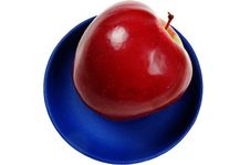 Free Juicy Apple On A Blue Dish Royalty Free Stock Photos - 4925428