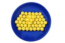 Blue Plateful Of Yellow Drops Vitamin Royalty Free Stock Image