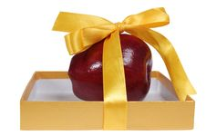 Red Apple In Box With Yellow Tape Like Gift Stock Photography