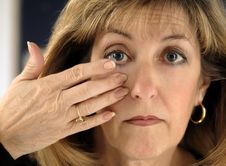 Free Woman Inserting Contact Lens In Eye Stock Image - 4925901