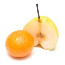 Tangerine And Pear Royalty Free Stock Photos