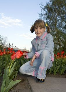 Free The Girl And Tulips Stock Images - 4930074