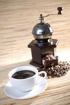 Cup Of Coffee And Grinder Stock Images