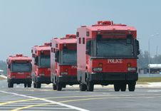 Four Red Police Trucks Stock Photo