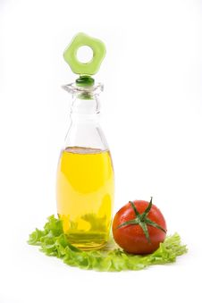 Free Bottle With Oil And Tomato Stock Images - 4938614