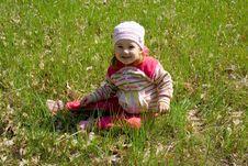 Free Child Sitting On Grass Royalty Free Stock Image - 4938826