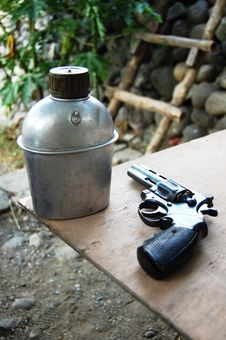 Free Soldier S Flask An Pistol Gun Royalty Free Stock Image - 4939196