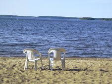 Two Chairs On The Coast Royalty Free Stock Photos