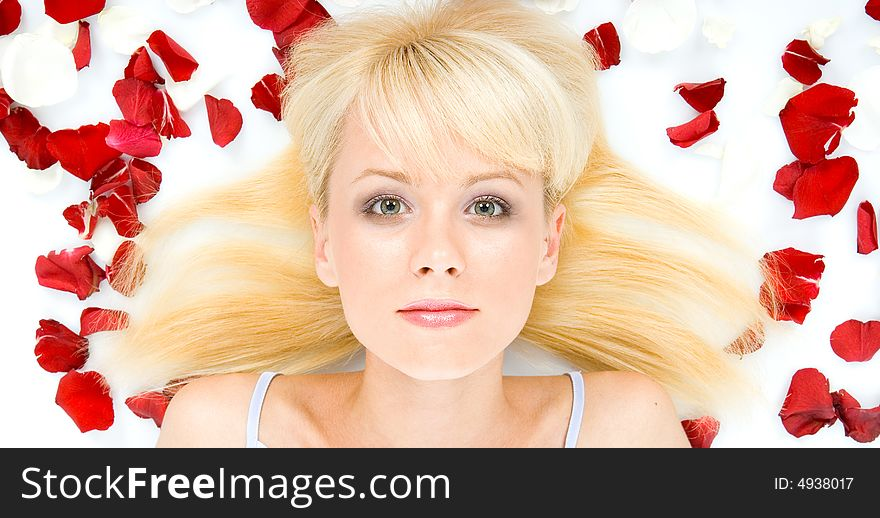 Young woman and   rose petals