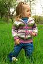 Free Little Girl Walks In The Spring On A Young Grass Stock Photo - 4941640