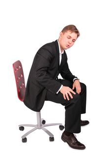 Young Man In Suit Sits On Chair Stock Image