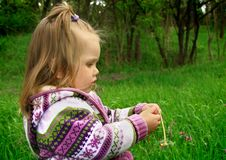 Free Little Girl Walks In The Spring On A Young Grass Stock Photos - 4941963