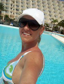 Happy Girl In The Pool Stock Photos