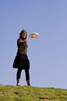 Free Happy Young Woman Throwing Her Beret Royalty Free Stock Images - 4942669