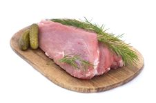 Free Raw Pork Schnitzel With Pickled Cucumbers And Dill Stock Photos - 4944503