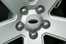 Free Car Tire Wheel And Lug Nuts Royalty Free Stock Photo - 4946685