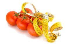Free Measuring Tape Around Tomatoes Stock Image - 4949231