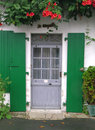 Free Grey Wooden Door With Green Shutters Royalty Free Stock Image - 4951786
