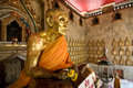 Free Seated Buddha In A Thai Temple Covered In Gold Lea Royalty Free Stock Image - 4954756