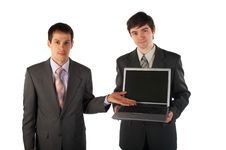 Free Two Young Businessmen Show Laptop Stock Photos - 4950073