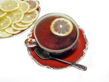 Free Ancient Teacup With Black Tea And Lemon Stock Photography - 4950412