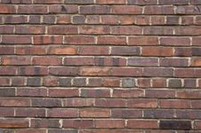 Free Dark Brown Red Brick Wall Stock Photography - 4951692