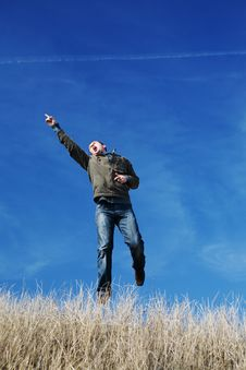 Flying Man Over The Field Stock Images