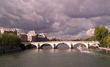 Free Boat Under A Paris Bridge Stock Photography - 4955972