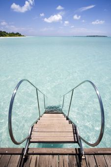 Free Jetty Leading Into Tropical Sea Royalty Free Stock Photo - 4957765