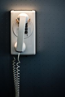 Free White Telephone Mounted On A Wall Royalty Free Stock Photo - 4958855