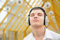 Free Young Man Listens Music Royalty Free Stock Photos - 4964748