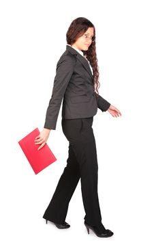 Free Brown-haired Woman Goes With Red Folder Royalty Free Stock Photo - 4961925