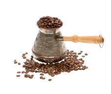 Free Cezve With Coffee Beans Over White Background Royalty Free Stock Images - 4962769