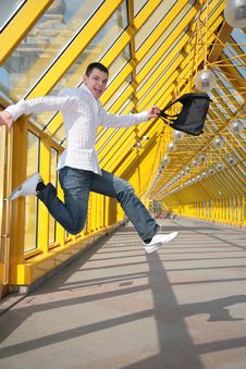Young Man Jumps With Bag Stock Photography