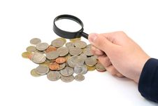 Free Coins And Magnifier In Hand Royalty Free Stock Photo - 4963875