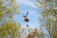 Rescue Helicopter Carrying Water Royalty Free Stock Photos