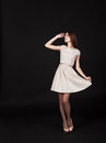 Free Young Beautiful Girl In A Light Dress Looking Up Royalty Free Stock Photography - 49620027