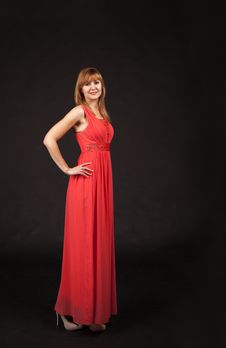 Young Beautiful Woman In Red Dress Posing Standing Royalty Free Stock Image