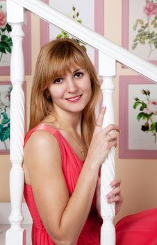 Free Beautiful Young Woman In A Red Dress Sitting On Stairs Stock Photo - 49620080