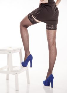 Free Long Female Legs In Black Stockings And Blue Shoes Royalty Free Stock Images - 49620089