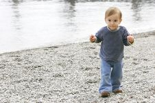 Free Baby Boy On Pebble Beach Royalty Free Stock Photo - 4971415