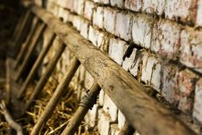 Free Old Ladders Laying On Brick Wall Royalty Free Stock Image - 4973776