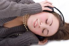 Cute Brunette With Earphones Stock Photography