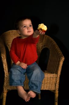 Free Child Sitting In Tha Armchair And Giving Apple Royalty Free Stock Photography - 4974237