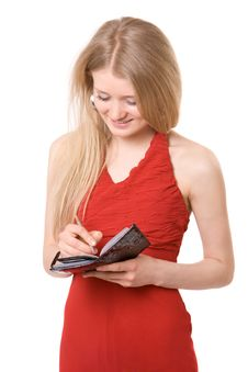 Attractive Girl Write To Notebook Stock Image