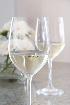Free White Wine In Glass With Flowers In Background Stock Photos - 4976853
