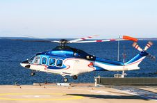 Free Helicopter Flies Up Near The Sea. Stock Photos - 4982603